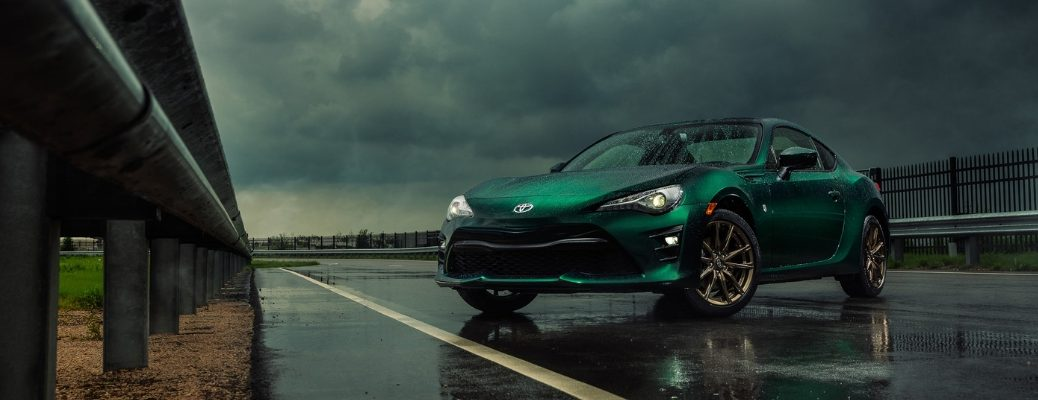 Green 2020 Toyota 86 on wet pavement