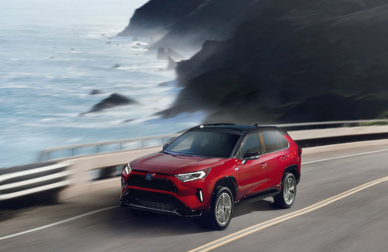 2021 Toyota RAV4 Prime in red by the sea