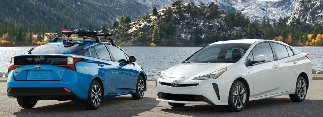 Two 2021 Toyota Prius models in blue and white