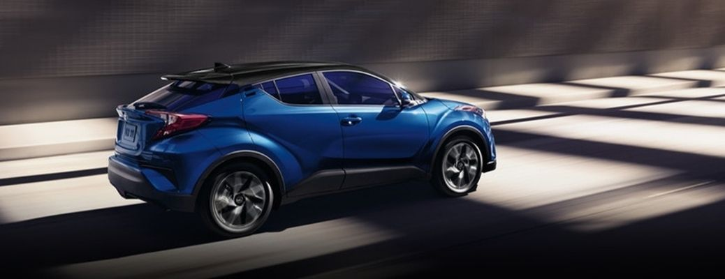 The side view of a blue-colored 2021 Toyota C-HR.