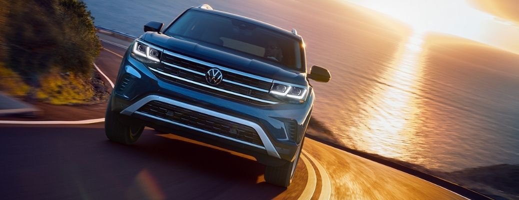front view of the 2021 VW Atlas with a lake in the background