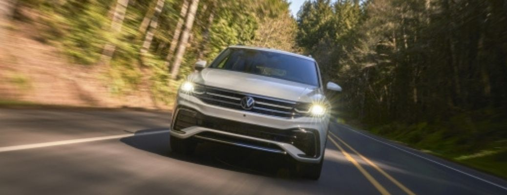 front view of the 2022 Volkswagen Tiguan with headlights on