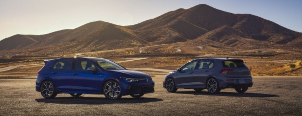 2022 VW Golf R and GTI parked opposite to each other