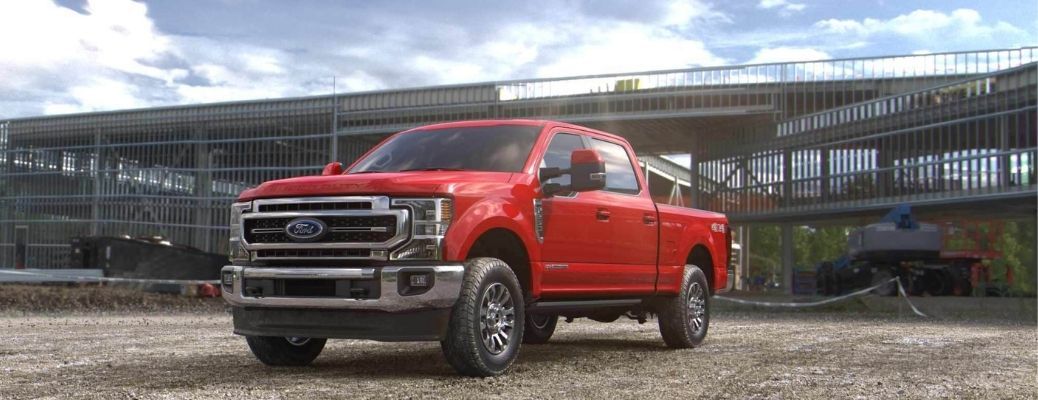 Ford Super Duty Race Red parked in a field