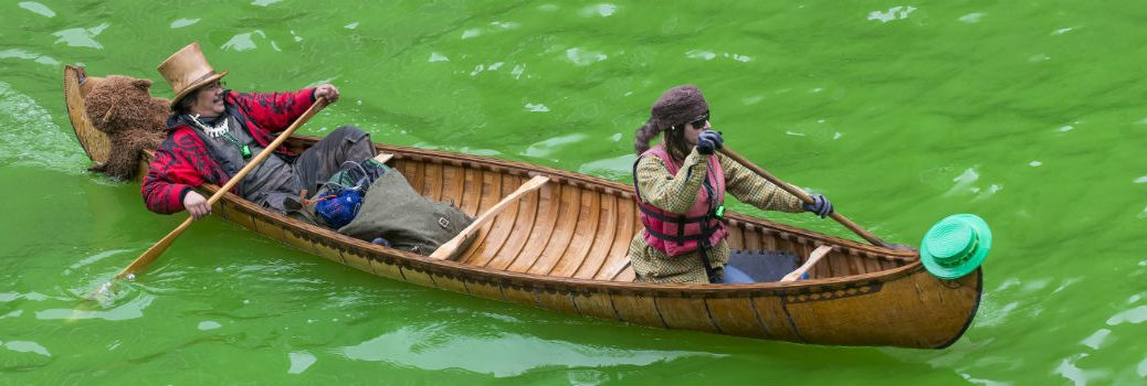 two people canoeing down green river