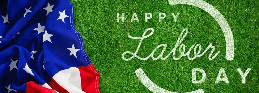 """American flag over grass with """"Happy Labor Day"""" text"""