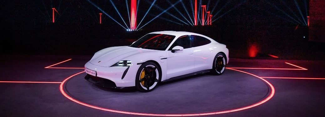 White 2020 Porsche Taycan on Red and Black Stage at China Debut