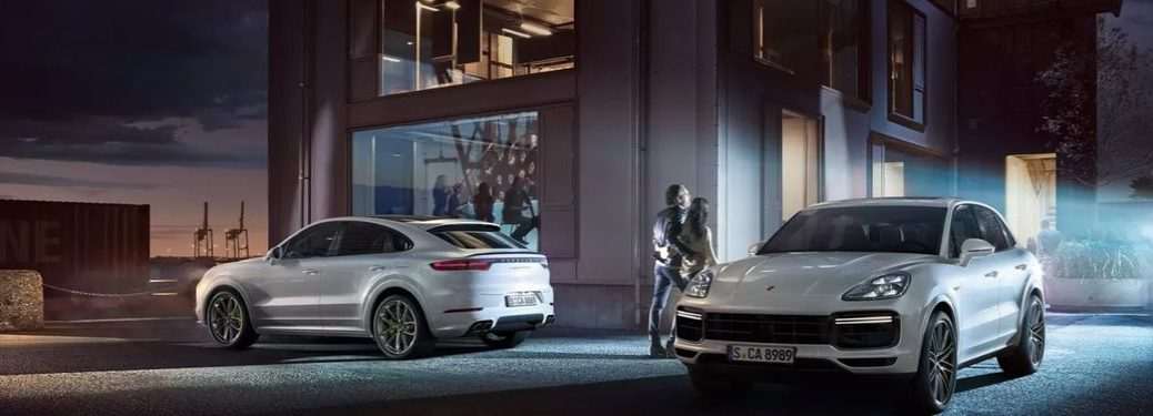 White Porsche Cayenne Coupe Rear Exterior and White 2020 Porsche Cayenne Coupe Front Exterior in Driveway at Night