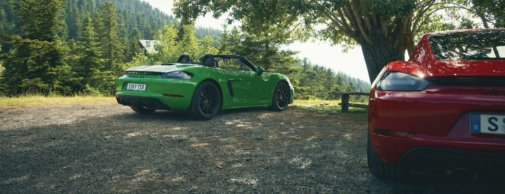 Rear view of green and red Porsche GTS 4.0 models