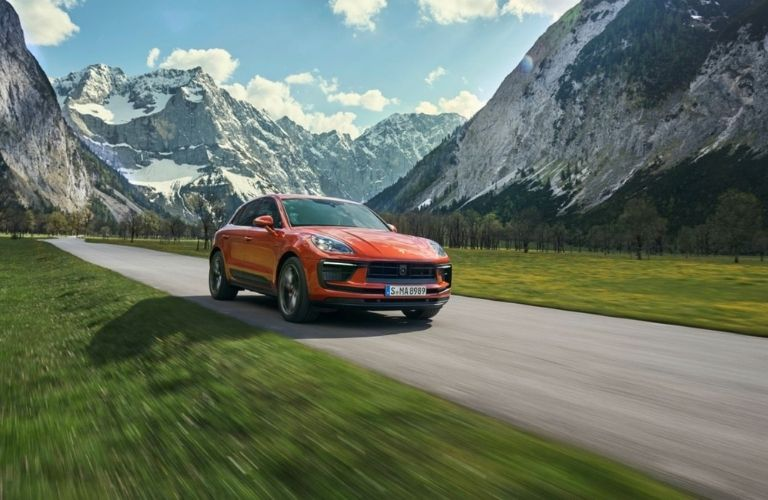 The 2022 Porsche Macan against the backdrop of snow-capped mountains