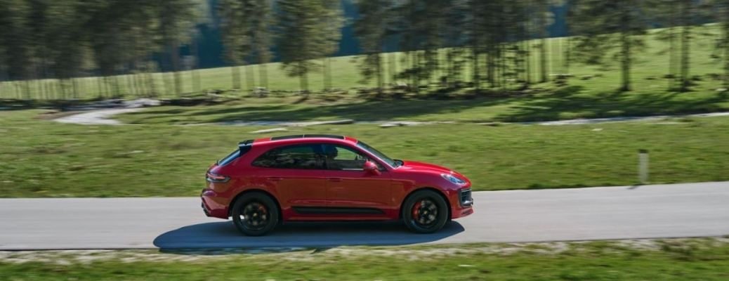 2022 Porsche Macan driving on the road