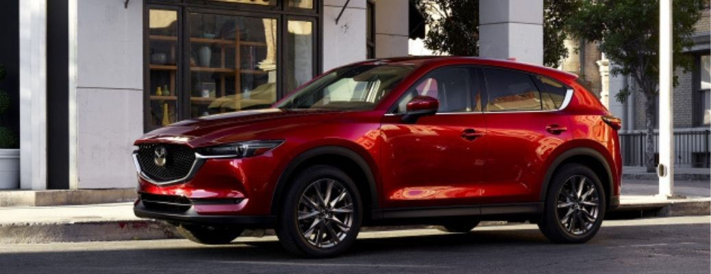2021 Mazda CX-5 in red color standing in an urban setting