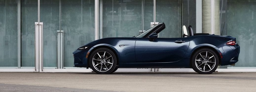 2021 Mazda MX-5 Miata Deep Crystal Blue Mica parked on the side of the road