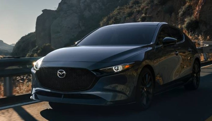 2021 Mazda3 Hatchback parked on a mountainous road