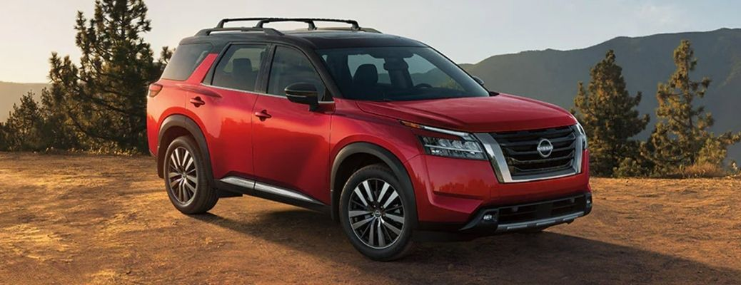 The 2022 Nissan Pathfinder parked on a dusty road