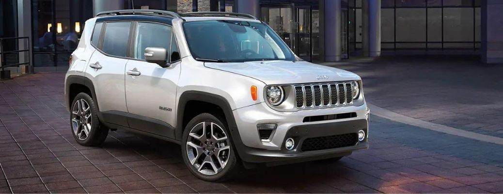 2021 Jeep Renegade Alpine White parked outside a building