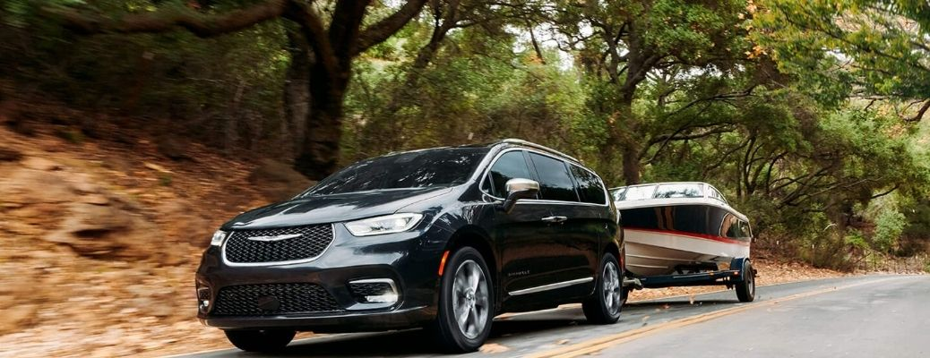 2021 Chrysler Pacifica Black towing a boat