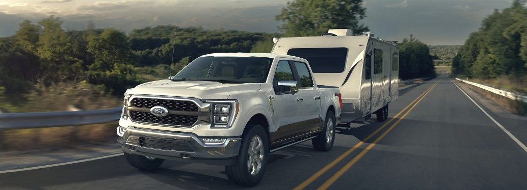 2021 Ford F-150 towing a camper on a road