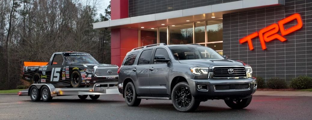 2022 Toyota Sequoia towing a truck. What is the gas mileage?