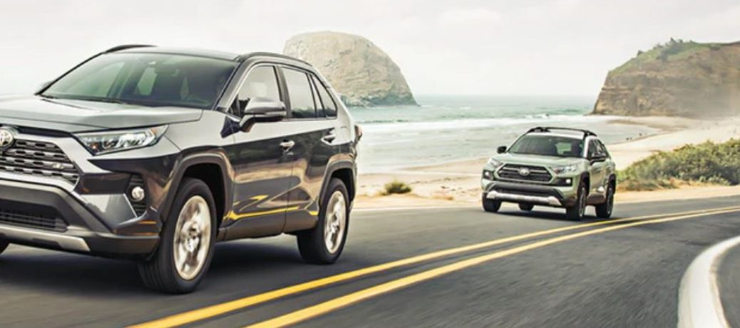 Two 2021 Toyota RAV4 driving on the road