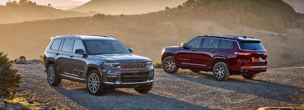 Two 2021 Jeep Grand Cherokee L models in the mist at sunrise
