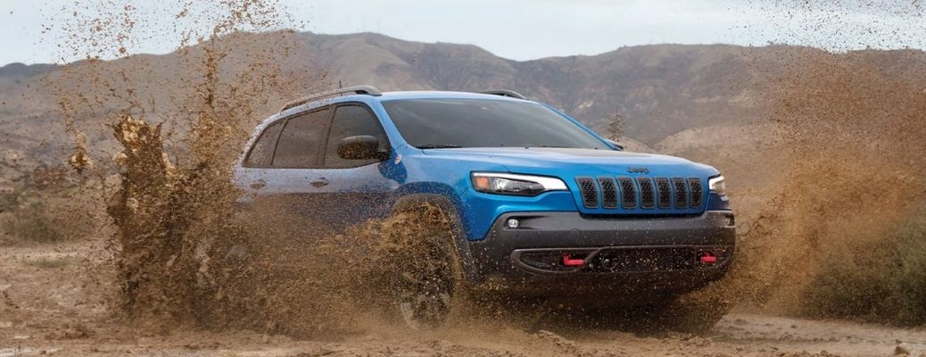 Blue 2021 Jeep Cherokee in the mud. WHat is the fuel economy rating?