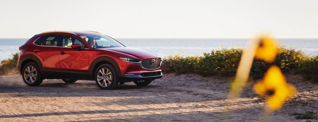 A right profile photo of the 2021 Mazda CX-3 parked at the beach.
