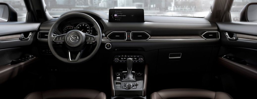 A photo of the dashboard in a Mazda crossover SUV.
