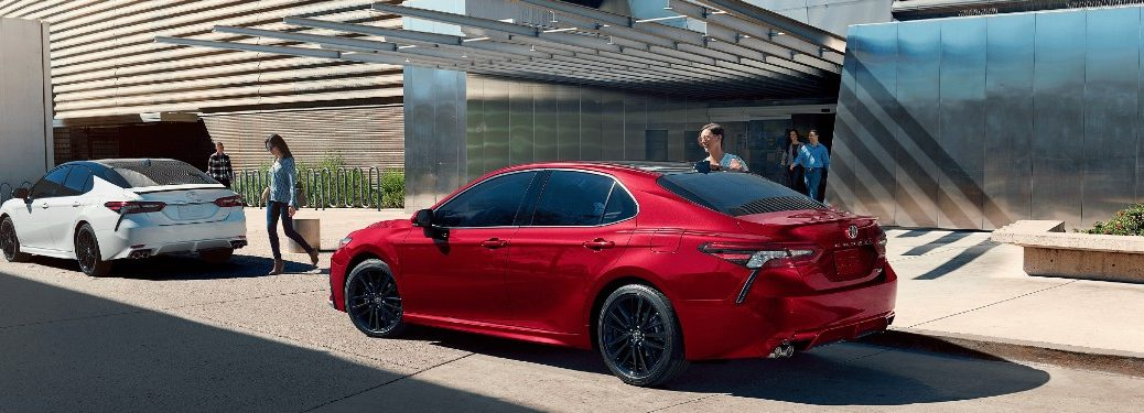 Tow 2021 Toyota Camry sedans parked on a street