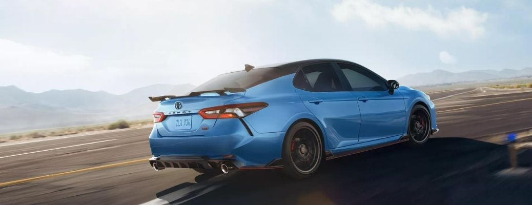 Blue 2022 Toyota Camry cruising on a road. What are the safety features?