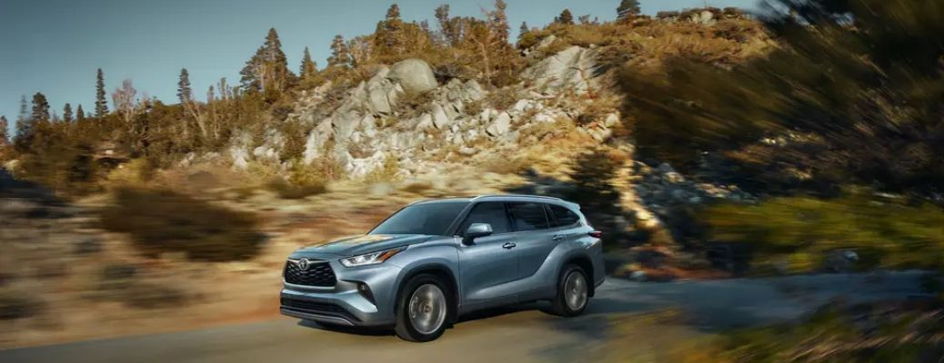 2021 Toyota Highlander driving in the forest
