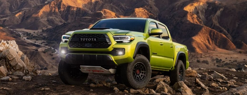 Front view of a 2022 Toyota Tacoma TRD Pro on a off-roading track. What are the safety features?