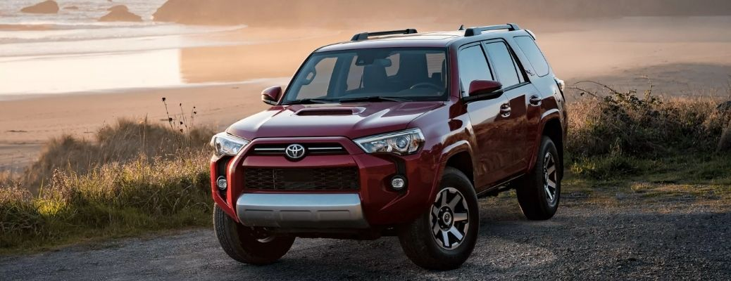 Front view of a red 2022 Toyota 4Runner on a beachside. What are the safety features?