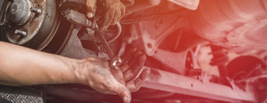 Car mechanic working on the brakes