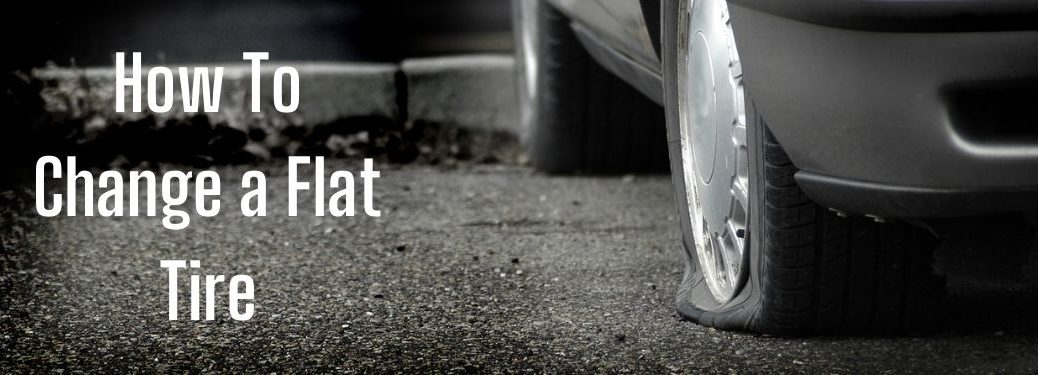 Close Up of Flat Tire with White How To Change a Flat Tire Text