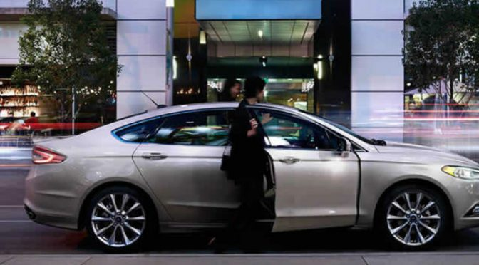 2016 Ford Fusion and a passenger