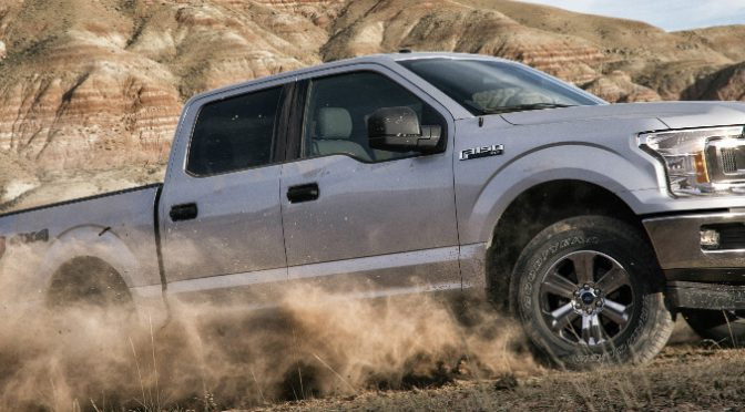Silver 2018 Ford F-150 Driving Off-Road in a Desert