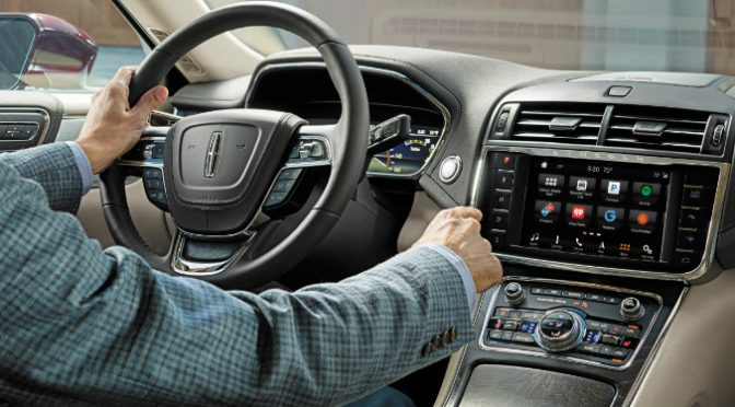 Man Using the Touchscreen in 2018 Lincoln Continental
