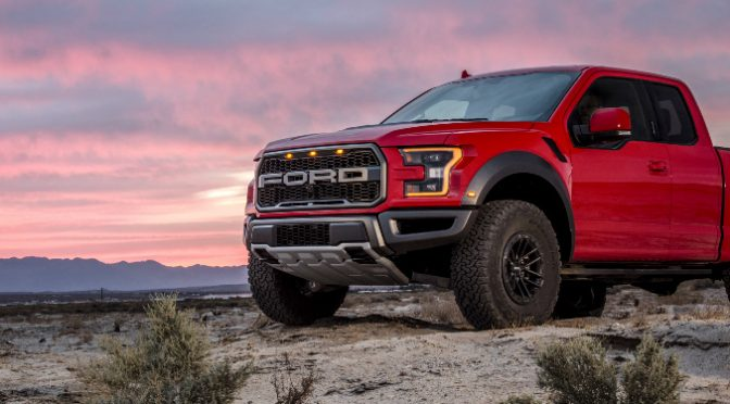 Red 2019 Ford F-150 Raptor with a Pink Sunset in the Background
