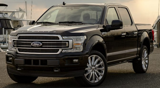 Front View of Black 2019 Ford F-150 Limited with Boats in the Background