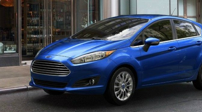 Blue 2018 Ford Fiesta Parked in Front of a Large Building