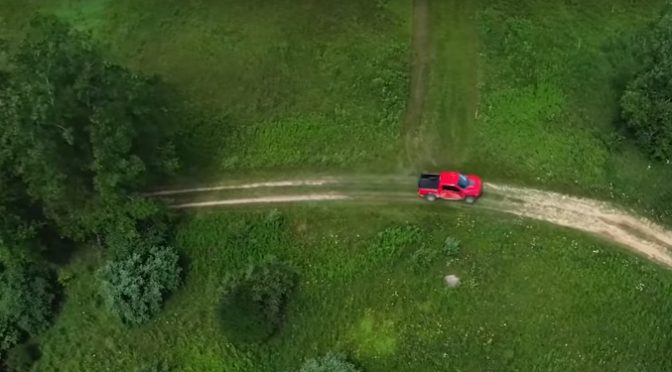 Aerial View of Red 2019 Ford F-150 Raptor Driving on a Country Road