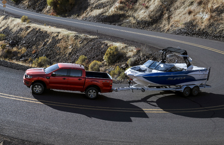 Red 2019 Ford Ranger Towing a Boat