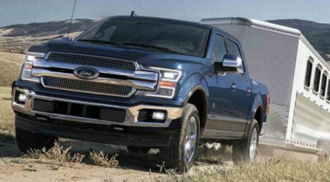 Blue 2018 Ford F-150 Towing a Horse Trailer