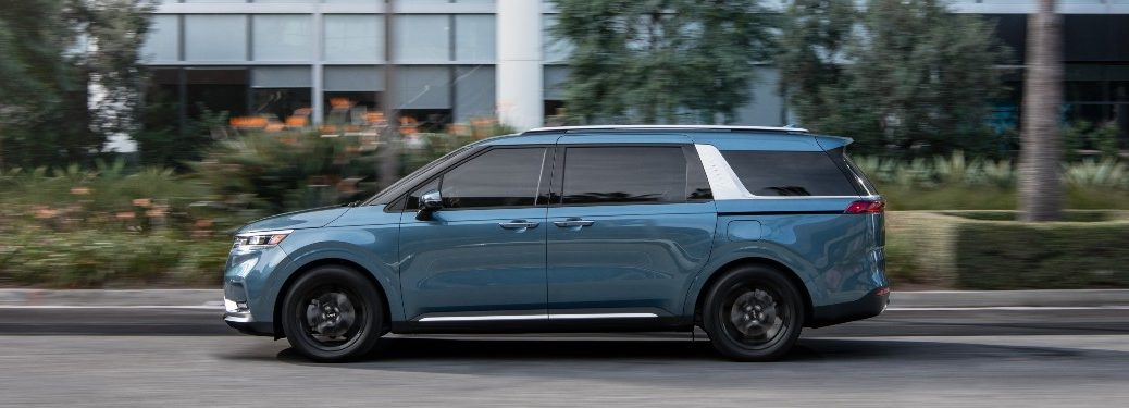 side view of a blue 2022 Kia Carnival