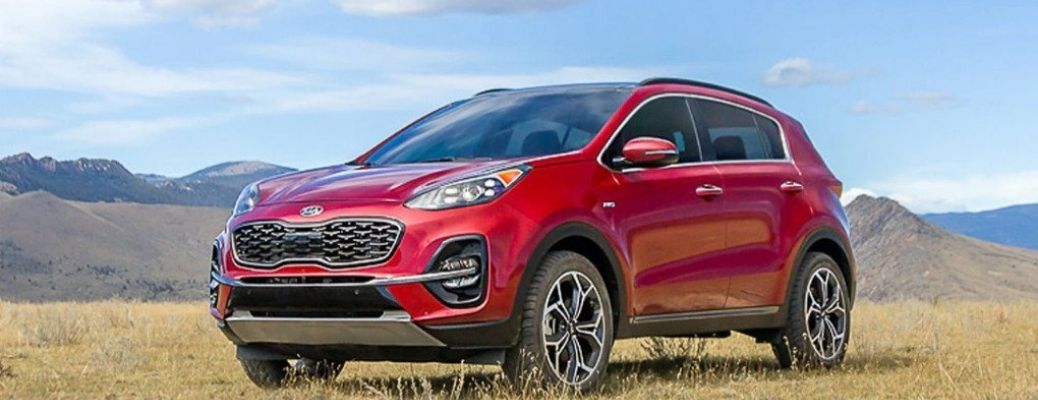 2022 Kia Sportage parked in front of a hill.