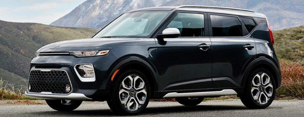 2021 Kia Soul parked in front of a hill