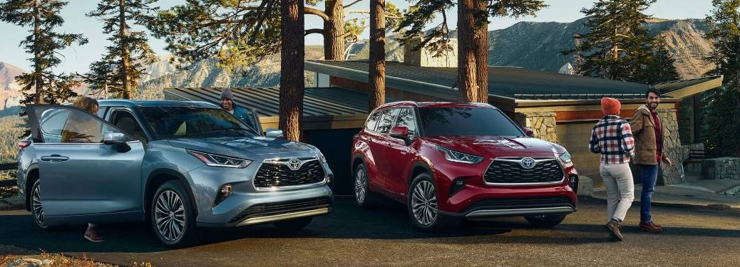 Two groups of people getting out of parked 2021 Toyota Highlander models.
