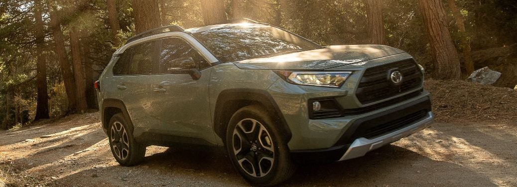 2021 Toyota RAV4 driving down a forest road