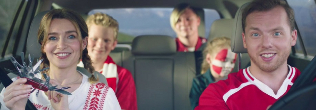 family dressed for world cup soccer mathc in volkswagen vehicle